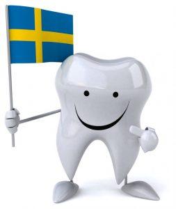 スウェーデンの旗を持ち自慢げな歯